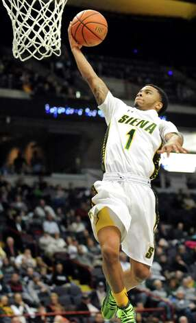 Siena's Marquis Wright goes to the hoop during their basketball game against Canisius on Thursday, Feb. 19, 2015, at Times Union Center in Albany, N.Y. (Cindy Schultz / Times Union) Photo: Cindy Schultz / 00030520B