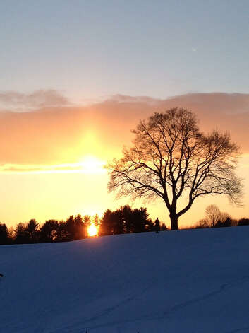 "Silvia Meder Lilly catches a glowing sunset at the Capital Hills Golf Course earlier this season. Lilly sees the site as as a winter recreation destination, but ""it is such an asset to residents regardless of the season."""