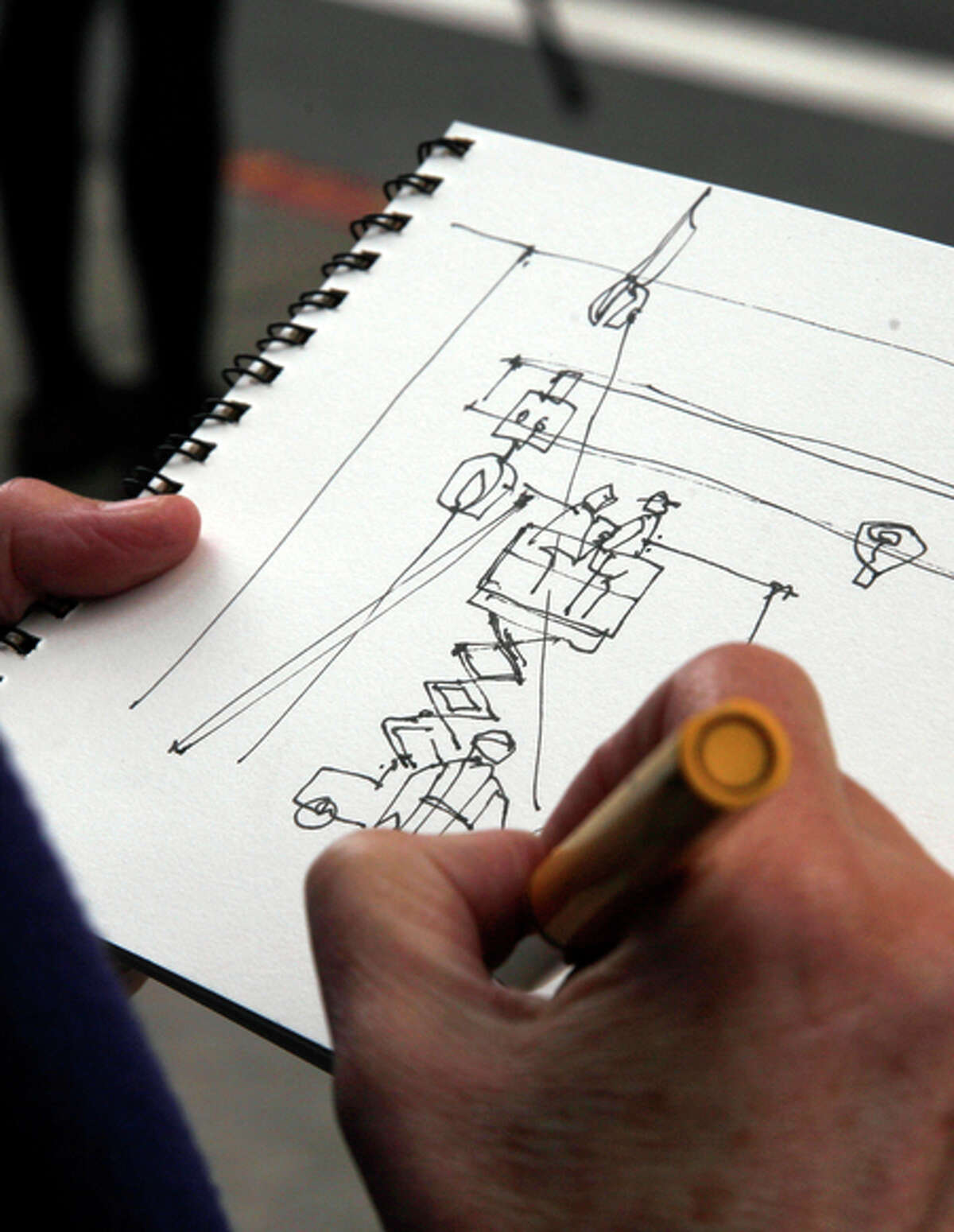 """Artist Cathy McAuliffe makes a sketch of """"Sequence."""""""