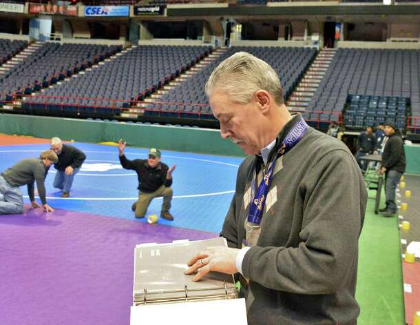 NYSPHSAA assistant director Bob Stulmaker oversees set up for the state wrestling championships Thursday Feb. 26, 2015, at the Times Union Center in Albany, NY. Event runs Friday and Saturday.  (John Carl D'Annibale / Times Union) Photo: John Carl D'Annibale / 00030774A