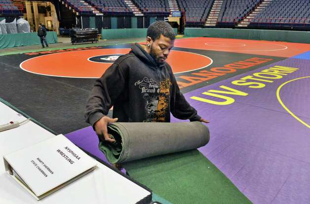 Chad Smith of the Times Union Center operations team sets up for the state wrestling championships Thursday Feb. 26, 2015, at the Times Union Center in Albany, NY. Event runs Friday and Saturday.  (John Carl D'Annibale / Times Union) Photo: John Carl D'Annibale / 00030774A