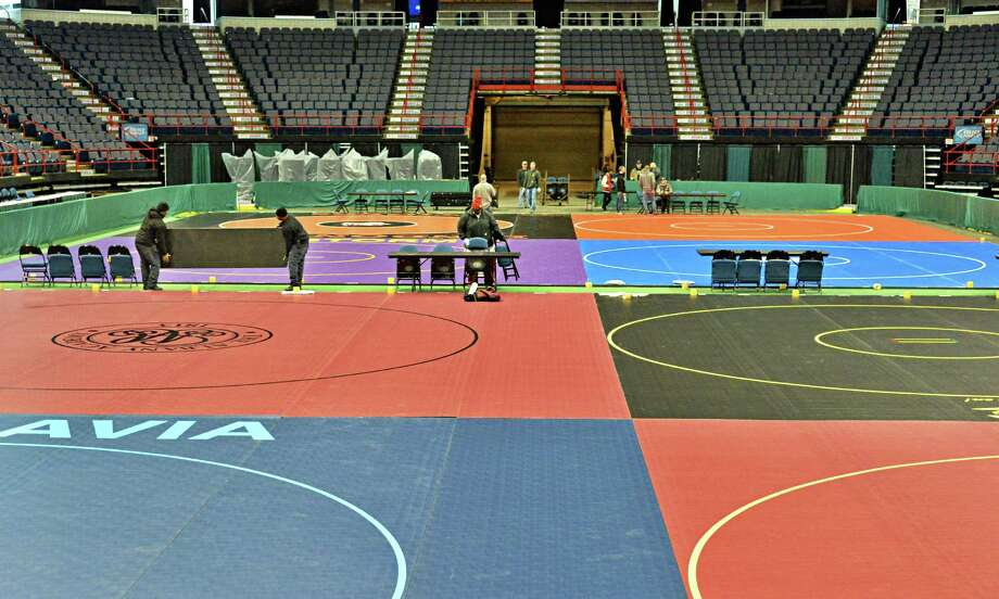 Crews set up for the state wrestling championships Thursday Feb. 26, 2015, at the Times Union Center in Albany, NY. Event runs Friday and Saturday.  (John Carl D'Annibale / Times Union) Photo: John Carl D'Annibale / 00030774A