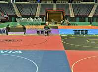 Crews set up for the state wrestling championships Thursday Feb. 26, 2015, at the Times Union Center in Albany, NY. Event runs Friday and Saturday.  (John Carl D'Annibale / Times Union)