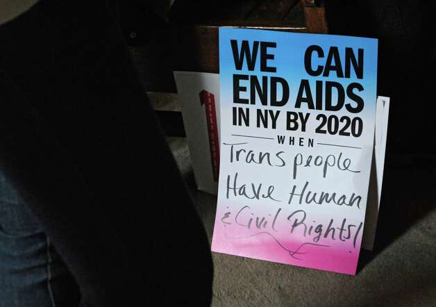 A sign is seen at an AIDS rally at the Capitol on Thursday, Feb. 26, 2015 in Albany, N.Y.  (Lori Van Buren / Times Union) Photo: Lori Van Buren / 00030776A