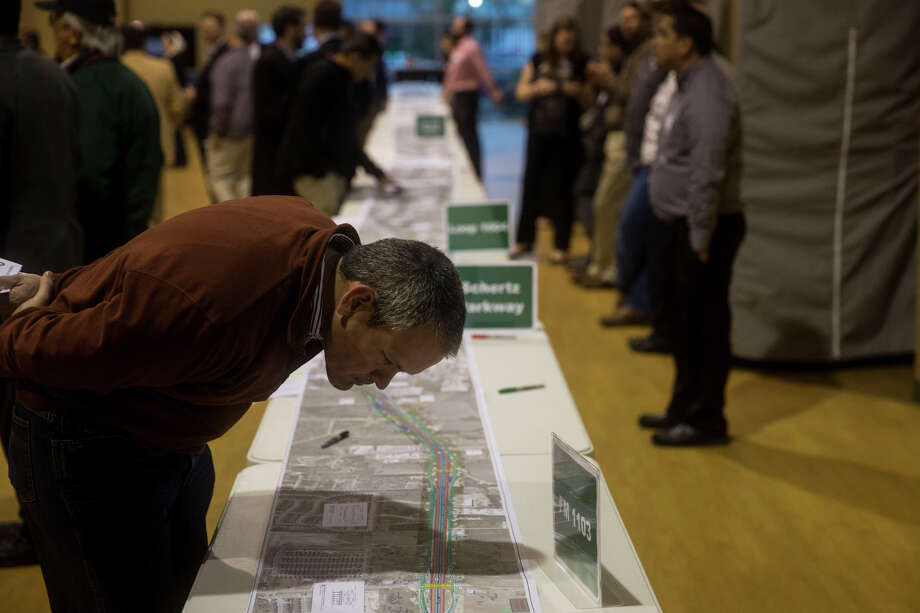 """Buck Benson looks at plans during a public meeting held by the Texas Department of Transportation about the I-35 Northeast San Antonio Expansion Project on Thursday, February 26, 2015 at Morgan's Wonderland in San Antonio, TX.  """"I am a lawyer representing developers, so this is a big deal to me,"""" he said. Photo: San Antonio Express-News / San Antonio Express-News"""