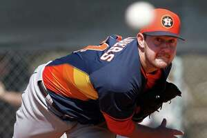 Houston Astros right handed pitcher Brady Rodgers (64) pitches during spring training workouts for pitchers and catchers at their Osceola County training facility, Sunday, Feb. 22, 2015, in Kissimmee. ( Karen Warren / Houston Chronicle  )