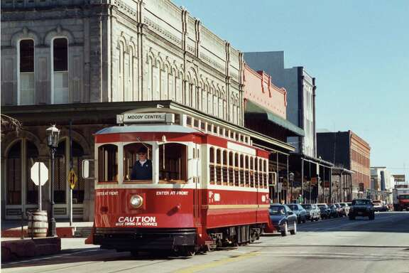 Galveston Trolley on Strand near 22nd St. in Galveston. The current plan calls for rubber-tired trolleys to run on steel rails.