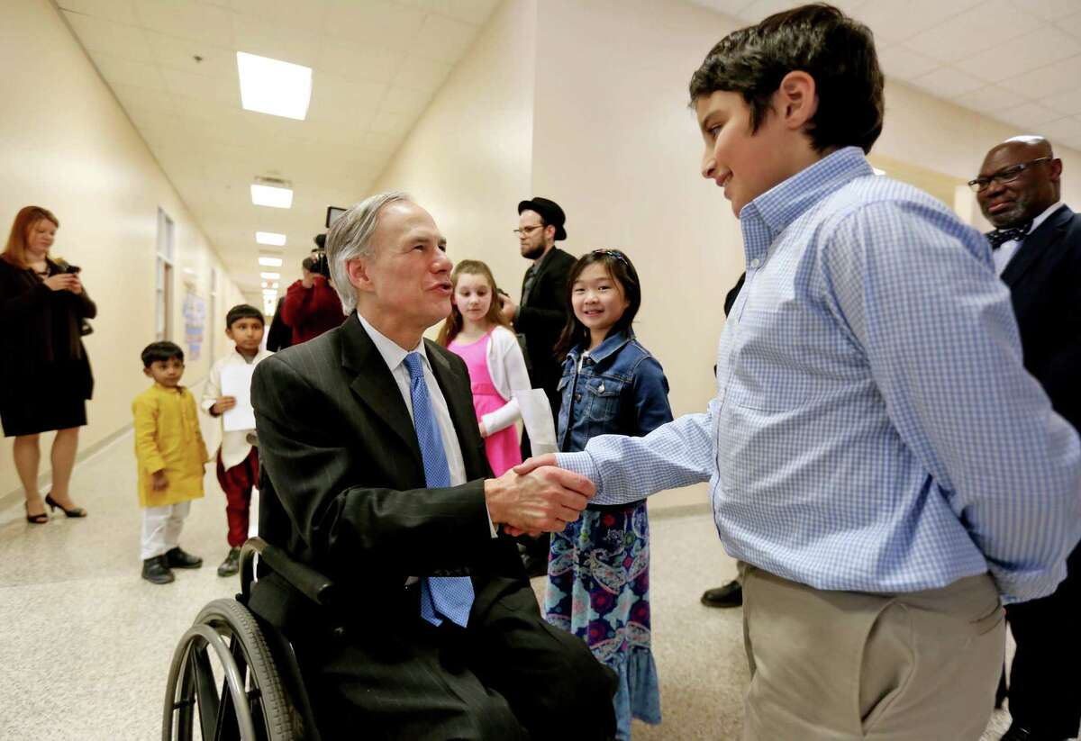 Governor Greg Abbott greets fifth-grader Kareem Barazi Thursday while visiting the School at St. George Place as part of a visit to Houston to talk to leaders about his urgent goals for early childhood education.