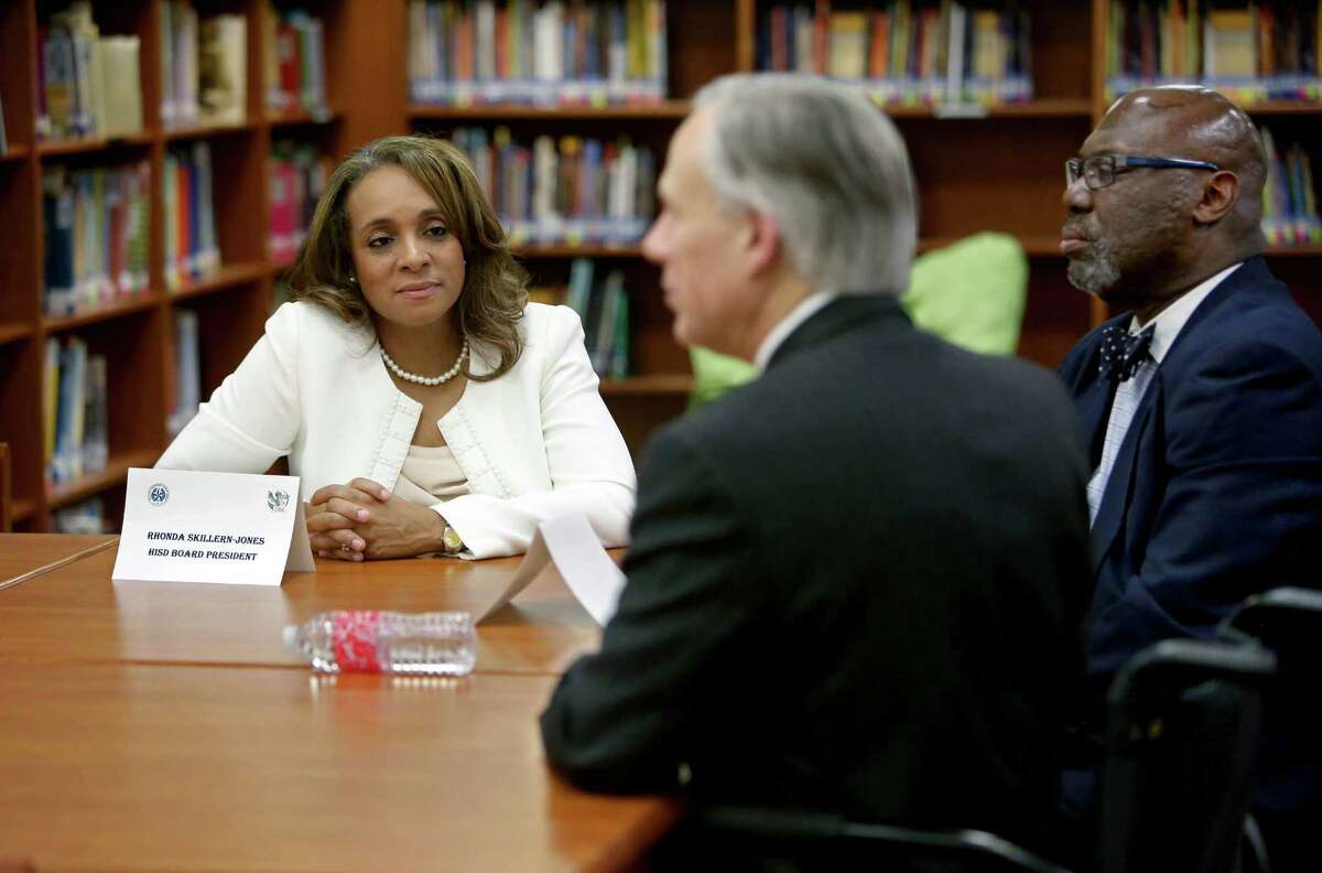 HISD Board President Rhonda Skillern-Jones, left, and Texas Education Agency Commissioner Michael Williams, right, meet Thursday with Governor Greg Abbott in the library of the School at St. George Place to speak about improving the state's early education.