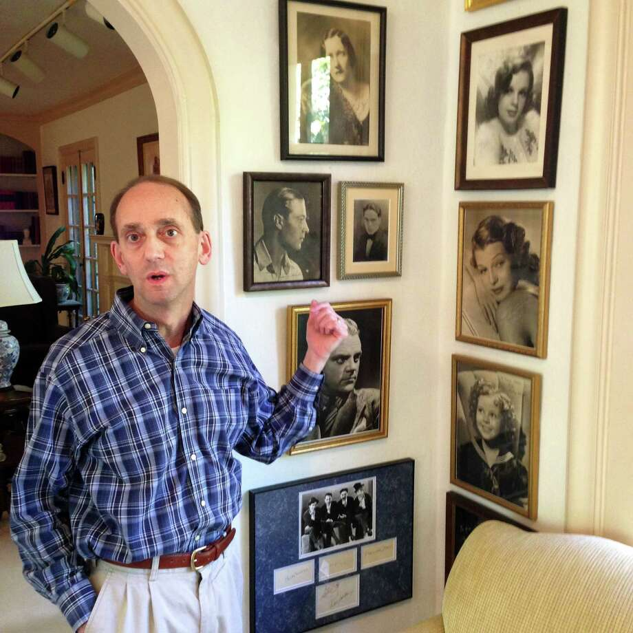 In this October photo, Missouri Auditor Tom Schweich shows off some of the movie-star photos in his home collection of autographed memorabilia from the golden age of Hollywood. Photo: David A. Lieb /Associated Press / AP