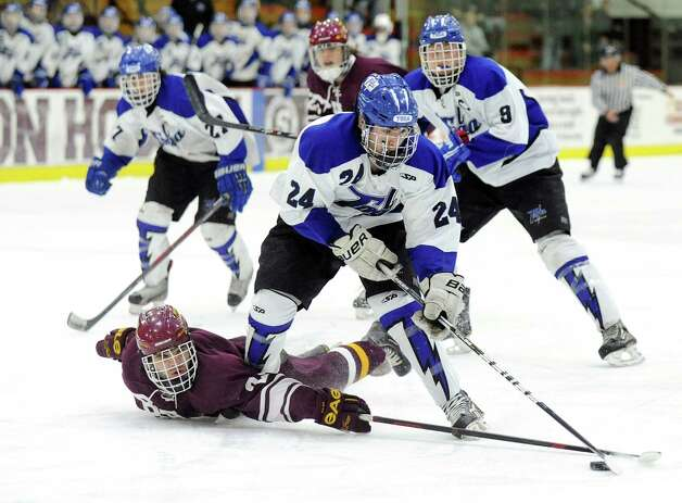 Saratoga Springs' Jake Fauler, center, gets ready to shoot for a first-period goal as Burnt Hills' Nick Koszelak defends during their Division I hockey final on Thursday, Feb. 26, 2015, at Union College in Schenectady, N.Y. (Cindy Schultz / Times Union) Photo: Cindy Schultz / 00030761A