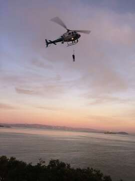 A vandalism suspect was lifted to safety by a California Highway Patrol helicopter after scrambling down a waterfront cliff to avoid arrest near Fort Baker in Marin County on Thursday, officials said.