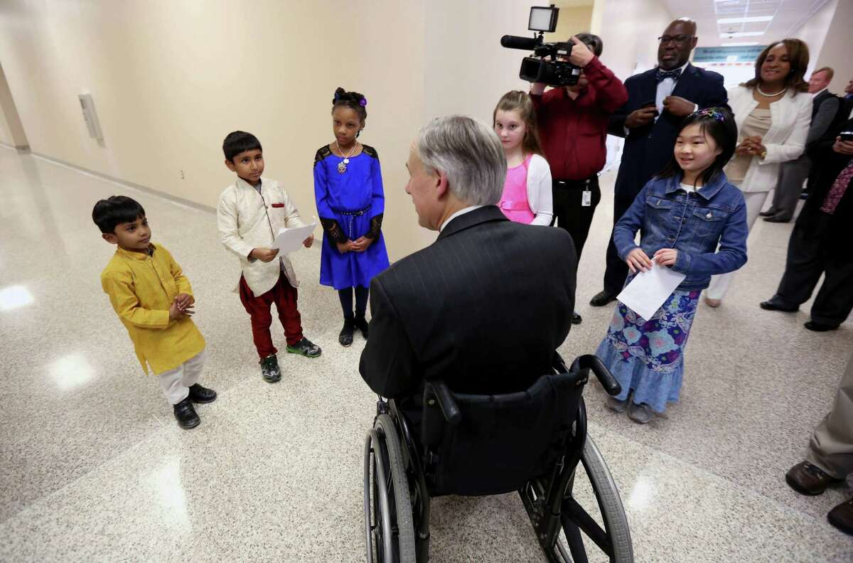 Governor Greg Abbott is greeted by, from left to right, Madhav Rajesh, pre-k, Rodra Kharel, first-grade, Mia Simmons, second-grade, Chloe Bidault, third-grade, and Caitlin Liman, fourth-grade, while visiting the School at St. George Place Thursday, Feb. 26, 2015, in Houston, Texas. Governor Abbott visited Houston to speak to Pre-K classes as part of his State of the State Tour.