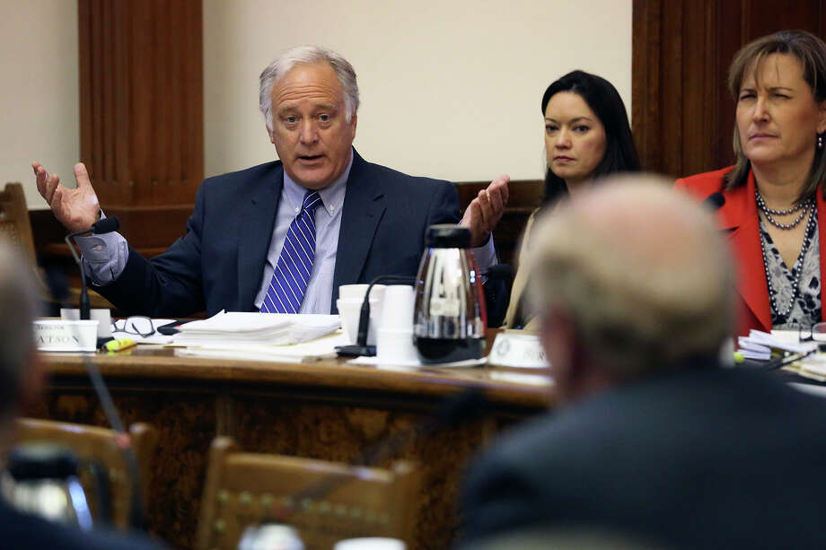 Senator Kirk Watson stresses a point with Robert S. Hicks as the Senate Committee on Nominations questions candidates for the University of Texas System Board of Regents at the State Capitol on February 26, 2015. Photo: Tom Reel, San Antonio Express-News