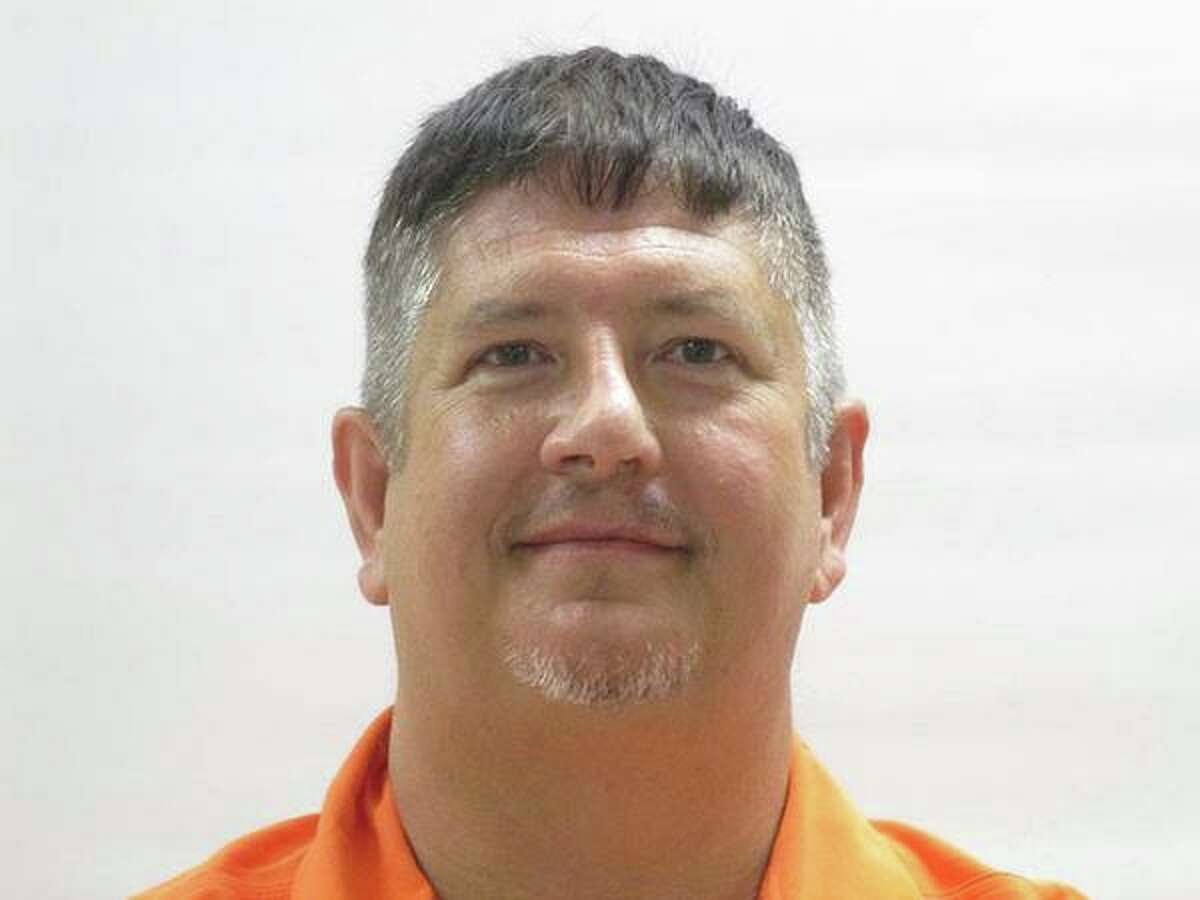 John Chambers, Indian Lake Police Department chief, is charged with 14 counts of tampering with governmental records, according to a news release from the Cameron County District Attorney's Office. The police chief was previously indicted on felony charges in August after he allegedly traveled outside of his jurisdiction to retrieve a truck for his wife's security company when a fired employee failed to return it, KGBT reported.  Pictured, Chambers in custody after the August indictment.