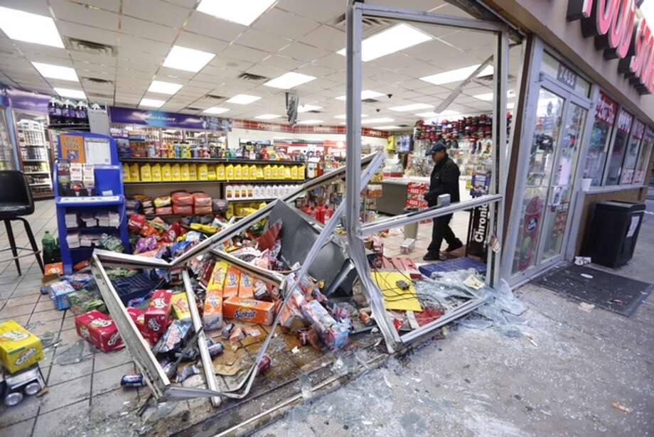Convenience store workers had a lot of cleanup to do early Friday morning after thieves rammed a red Ford F-250 through the front doors but failed to make off with an ATM in the 7400 block of Little York. A customer was injured and she was taken to an area hospital. Photo: Cody Duty / Houston Chronicle