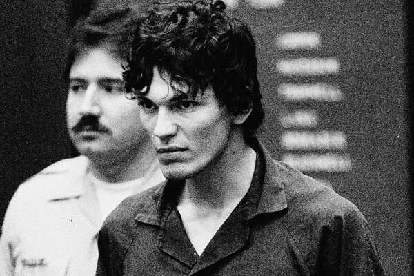 """** FILE ** Richard Ramirez, who was convicted for 13 counts of murder in the """"Night Stalker"""" serial killings, clenches his fists and pulls on his restraints in a court appearance in Los Angeles, in this Oct. 21, 1985, file photo. On Tuesday, June 6, 2006, the California Supreme Court considers an appeal by Ramirez, who maintains his defense lawyers were inexperienced in handling murder cases and exhibited bizarre behavior during his high-profile trial in the 1980s."""