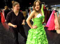 Sam Martin, 17, right, tries on a prom dress as Leslie Chotkowski of Schoharie looks to make alterations on Friday, March 30, 2012, at Schoharie High in Schoharie, N.Y. More than 300 dresses were collected to help make prom possible for the flood-stricken town. A similar program will be offered at the NY Women?s Expo on Saturday, Feb. 28, and Sunday, March 1, at Siena College. Dresses are $9.95 and proceeds benefit Big Brothers Big Sisters of the Capital Region. Find information at http://nywomensexpo.com/.  (Cindy Schultz / Times Union)