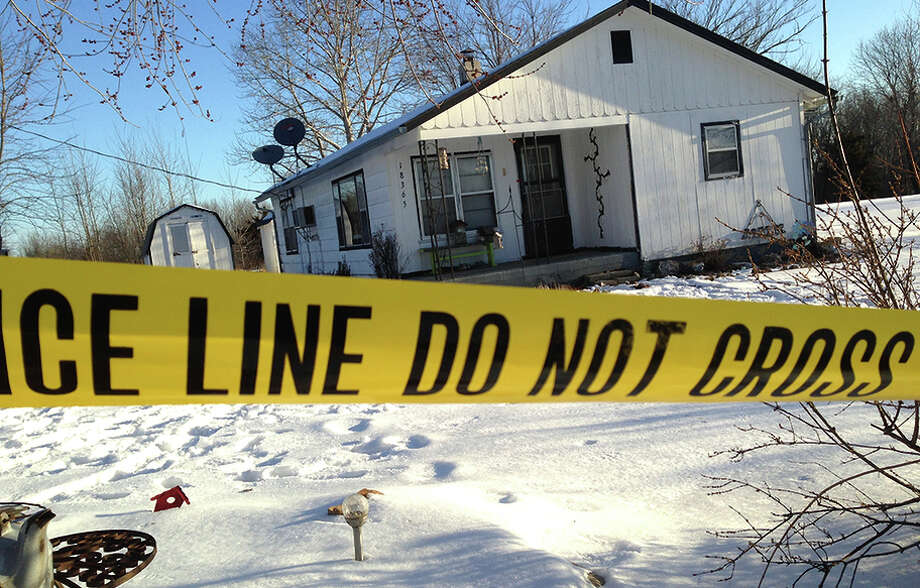 Police tape surrounds a crime scene in the shooting rampage that killed eight people, including the gunman, in Tyrone, Mo. Photo: Jeff McNiell / Associated Press / Houston Herald