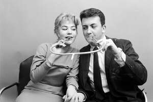 Cigarette holder made for two, 1955  Half the nicotine, twice the intimacy. But still.