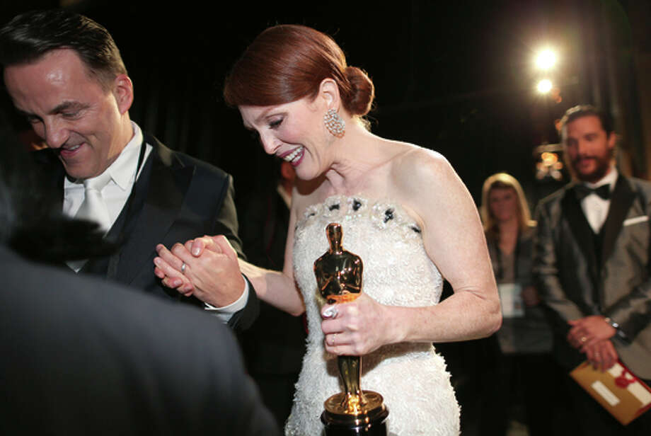 Julianne Moore and her best-actress Oscar are seen backstage. Photo: Christopher Polk / Getty Images / 2015 Getty Images