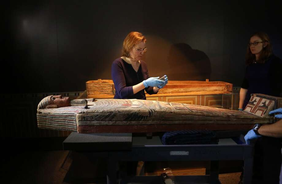 Renee Stein, Conservator of Emory University, is preparing to set in place the Egyptian coffin that will be on exhibit in the Egyptian Hall at the Houston Museum of Natural Science on Wednesday, Feb. 25, 2015. Photo: Mayra Beltran, Houston Chronicle