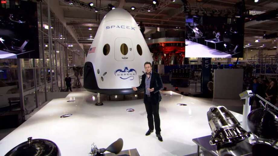Elon Musk reveals the Dragon V2, to be used to transport astronauts to the space station.