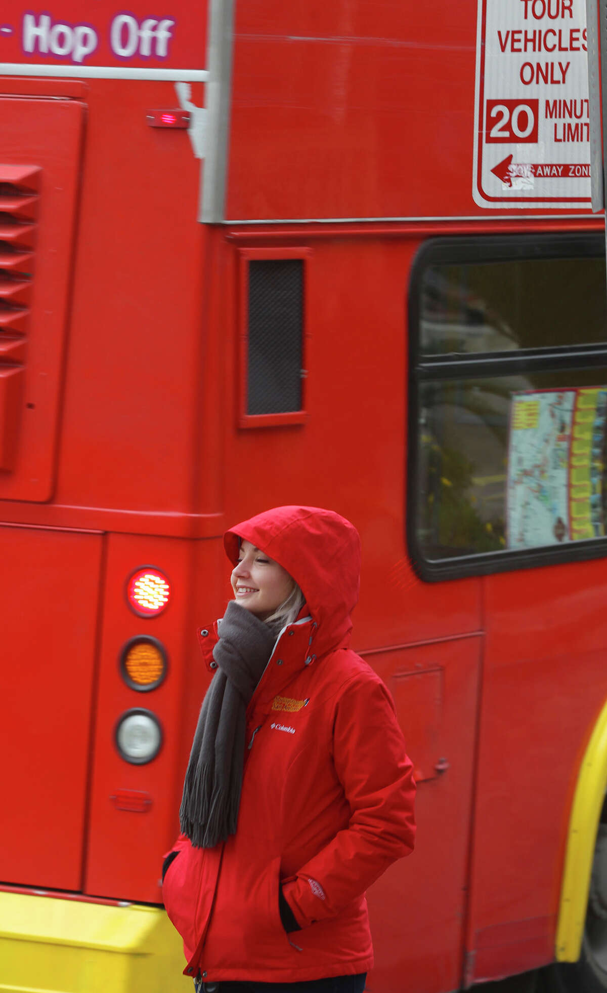 Lauren Julius is dressed for Friday's chilly temperatures February 27, 2015 at Alamo Plaza. Julius works for City Sightseeing Double Decker. Julius said she didn't think there would be very many people riding on the top deck because of the cold.