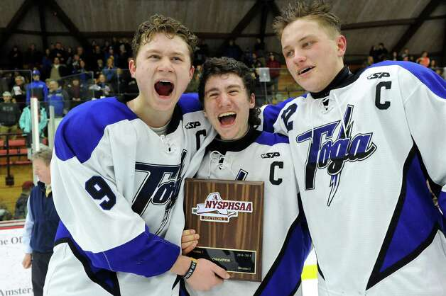 Saratoga Springs' captains Elliott Hungerford, left, JT Rafferty, center, and Ian Frey hold their award as they celebrate their 8-3 victory over Burnt Hills in their Division I hockey final on Thursday, Feb. 26, 2015, at Union College in Schenectady, N.Y. (Cindy Schultz / Times Union) Photo: Cindy Schultz / 00030761A
