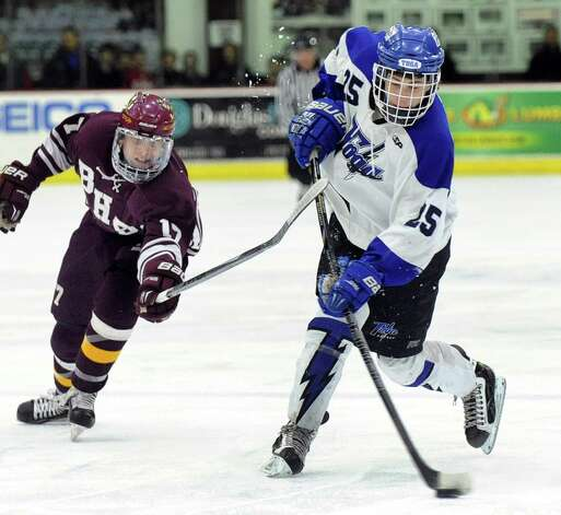Saratoga Springs' Josh Dagle, right, takes a shot as Burnt Hills' Sam Swingruber defends during their Division I hockey final on Thursday, Feb. 26, 2015, at Union College in Schenectady, N.Y. (Cindy Schultz / Times Union) Photo: Cindy Schultz / 00030761A