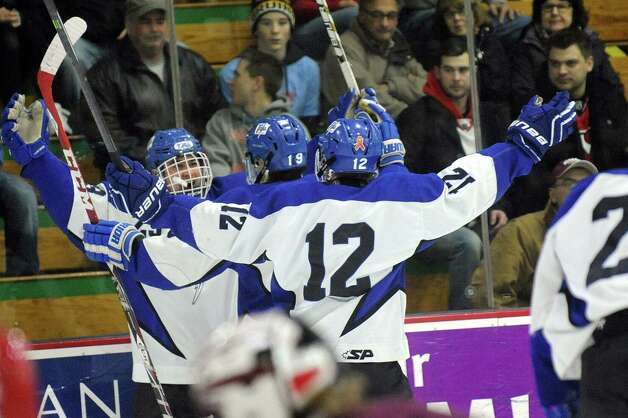 Saratoga Springs' Zach Guzi, left, celebrates his first-period goal during their Division I hockey final against Burnt Hills on Thursday, Feb. 26, 2015, at Union College in Schenectady, N.Y. (Cindy Schultz / Times Union) Photo: Cindy Schultz / 00030761A