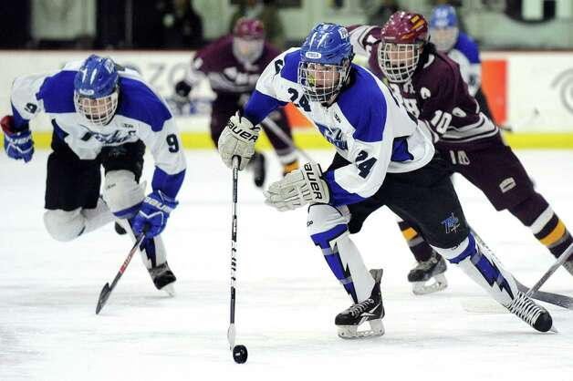Saratoga Springs' Jake Fauler, center, moves the puck during their Division I hockey final against Burnt Hills on Thursday, Feb. 26, 2015, at Union College in Schenectady, N.Y. (Cindy Schultz / Times Union) Photo: Cindy Schultz / 00030761A