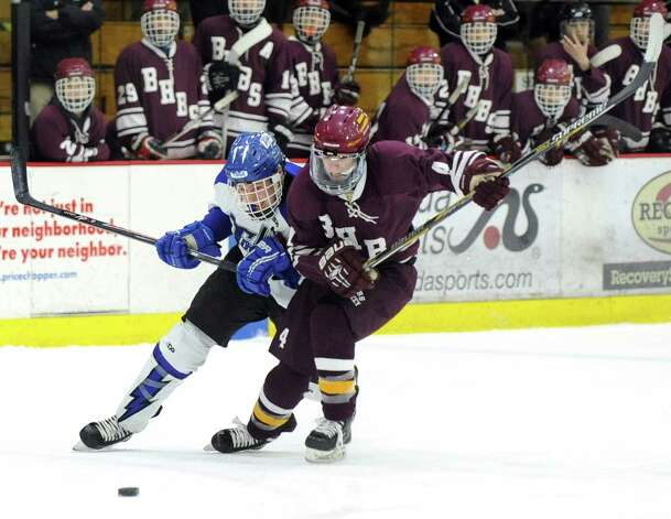 Saratoga Springs' Elliott Hungerford, left, and Burnt Hills Trey Swingruber battle for a loose puck during their Division I hockey final on Thursday, Feb. 26, 2015, at Union College in Schenectady, N.Y. (Cindy Schultz / Times Union) Photo: Cindy Schultz / 00030761A