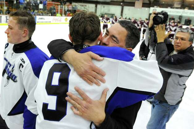 Saratoga Springs' coach Dave Torres, center, embraces Elliott Hungerford, who got a hat trick, as they celebrate their 8-3 victory over Burnt Hills in their Division I hockey final on Thursday, Feb. 26, 2015, at Union College in Schenectady, N.Y. (Cindy Schultz / Times Union) Photo: Cindy Schultz / 00030761A