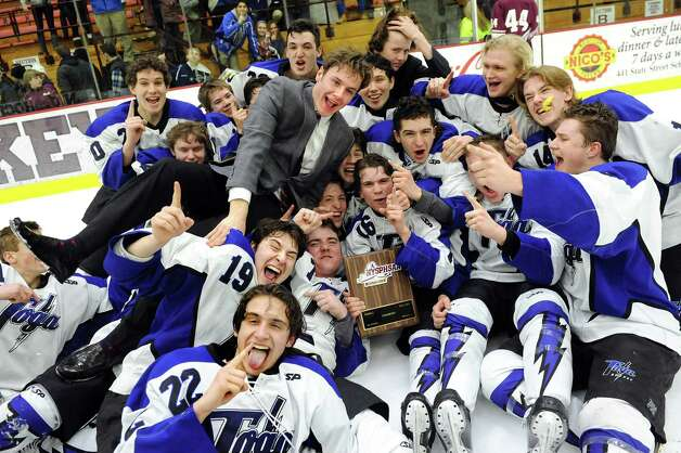 Saratoga Springs' players and coaches jump into the pile for a picture as they celebrate their 8-3 victory over Burnt Hills in their Division I hockey final on Thursday, Feb. 26, 2015, at Union College in Schenectady, N.Y. (Cindy Schultz / Times Union) Photo: Cindy Schultz / 00030761A