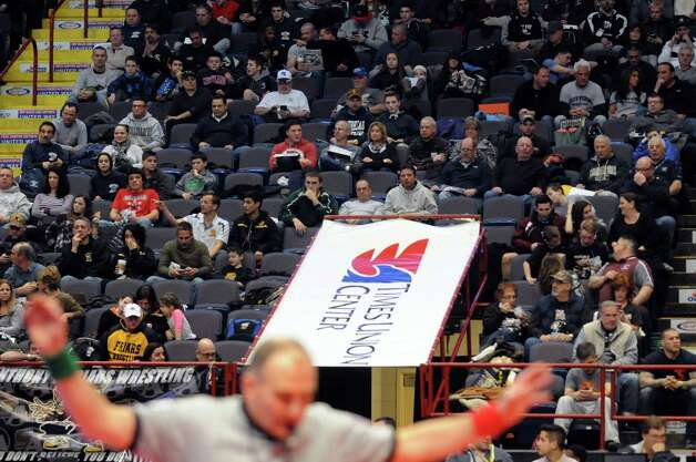 Wrestling fans pack the Times Union Center for the opening rounds of the 2015 State Wrestling Tournament on Friday Feb. 27, 2015 in Albany, N.Y. (Michael P. Farrell/Times Union) Photo: Michael P. Farrell / 00030780A
