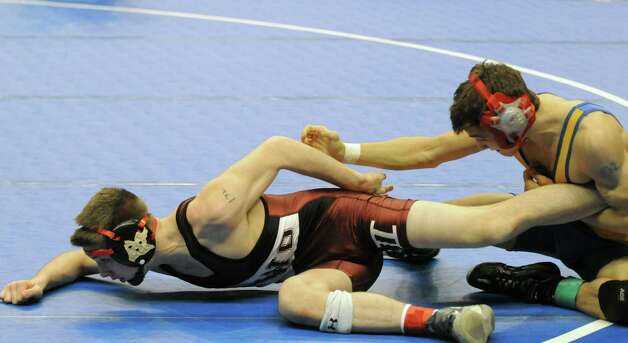 Albany Academy's Kyle Jasenski, left, and Dempsey King from New Hartford compete in the 132lb. class during the opening rounds of the 2015 State Wrestling Tournament at the Times Union Center on Friday Feb. 27, 2015 in Albany, N.Y. (Michael P. Farrell/Times Union) Photo: Michael P. Farrell / 00030780A