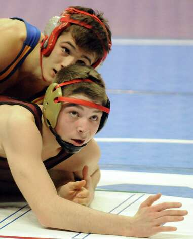 Albany Academy's Kyle Jasenski and Dempsey King from New Hartford compete in the 132lb. class during the opening rounds of the 2015 State Wrestling Tournament at the Times Union Center on Friday Feb. 27, 2015 in Albany, N.Y. (Michael P. Farrell/Times Union) Photo: Michael P. Farrell / 00030780A