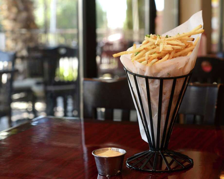 Frites, or french fries, at Tribeca 212: Among the techniques there, the fries are fried in canola oil and chilled between two fryings. Photo: Billy Calzada, San Antonio Express-News / San Antonio Express-News