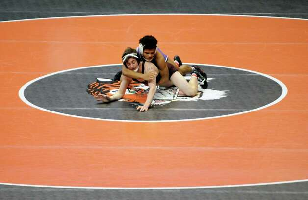 Niskayuna's Eoghan Sweeney and Penfield's Frankie Gissendanner compete in the 138lb. class during the opening rounds of the 2015 State Wrestling Tournament at the Times Union Center on Friday Feb. 27, 2015 in Albany, N.Y. (Michael P. Farrell/Times Union) Photo: Michael P. Farrell / 00030780A