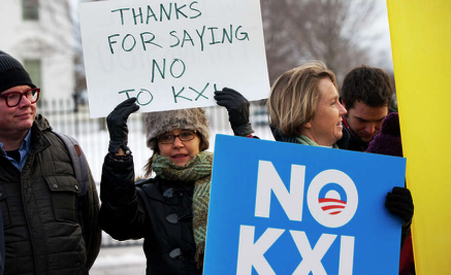Keystone XL pipeline foes celebrate the president's veto. Photo: Jacquelyn Martin / Associated Press / AP