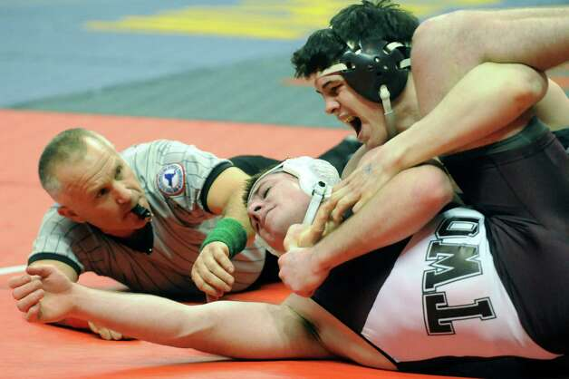 Columbia's Dylan Dubuque matches up against Tom Lane, right, of Garden City in their 182lb. match during the 2015 State Wrestling Tournament at the Times Union Center on Friday Feb. 27, 2015 in Albany, N.Y. (Michael P. Farrell/Times Union) Photo: Michael P. Farrell / 00030780A