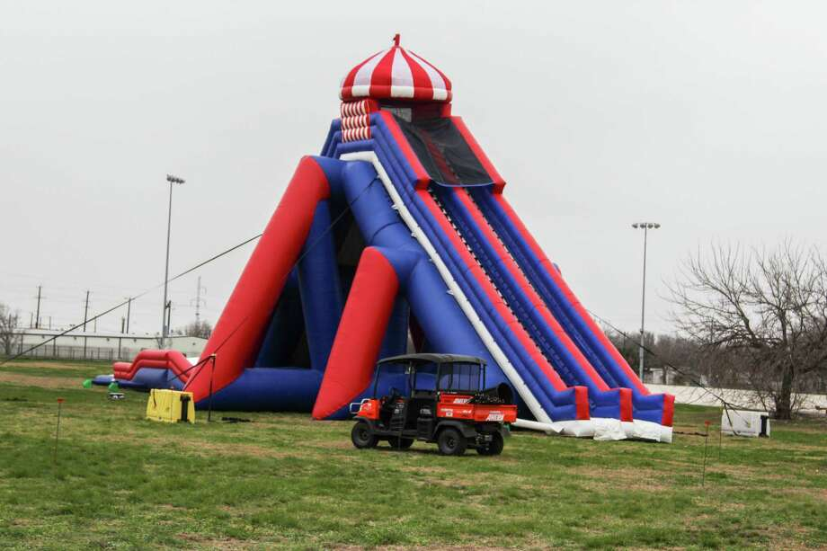 The Stunt Run 5K has partnered with Be The Match, which will benefit people with life-threatening blood cancers. The participants run through blow-up obstacles spread across the race course. Photo: Photo By Tyler White/SAEN
