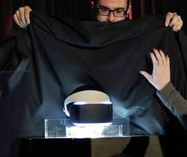 Sony staffers quickly cover the new Prometheus virtual reality headset at the end of the presentation announcing the device. Sony unveiled a prototype virtual reality headset on Tuesday, March 18, 2014, in San Francisco, Calif., during the Sony Game Developers Conference. The move signals Sony's leap into the race to sell virtual reality gaming gear. The prototype is code-named Morpheus and is made for the Playstation 4.