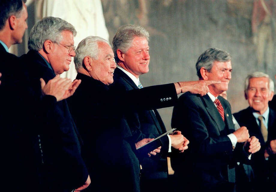 In July 2000, the Rev. Theodore Hesburgh (pointing) received a Congressional Gold Medal at a ceremony at the Capitol in Washington that included President Bill Clinton (center). Photo: RAY LUSTIG / Washington Post / THE WASHINGTON POST