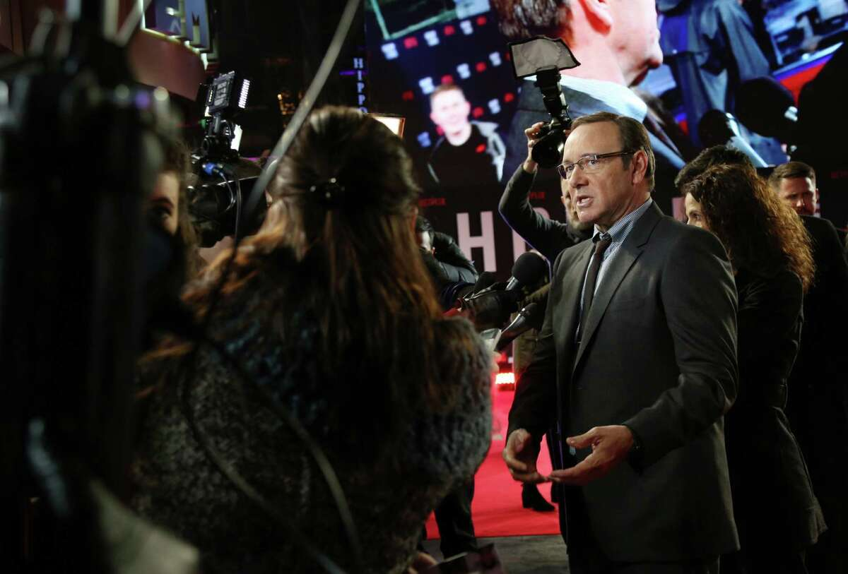 Actor Kevin Spacey talks to media upon arrival at the House Of Cards season 3 World Premiere at the Empire Cinema in central London, Thursday, Feb. 26, 2015. (Photo by Joel Ryan/Invision/AP)