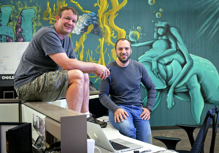 WhatsApp founders Brian Acton, left, and Jan Koum at company headquarters in Mountain View, Calif., May 23, 2013. The frenzy to acquire fast-growing technology startups reached new heights on Feb. 19, 2014 as Facebook announced its largest ever acquisition, saying it would pay at least $16 billion for WhatsApp, a text messaging application with 450 million users around the world. (Peter DaSilva/The New York Times)