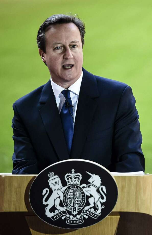 "Prime Minister David Cameron delivers a speech at the Millennium Stadium in Cardiff. Cameron defended Britain's security services and vowed to defeat Islamic extremists after media reports named Islamic State executioner ""Jihadi John"" as London graduate Mohammed Emwazi. Photo: BEN BIRCHALL / AFP / Getty Images / AFP"