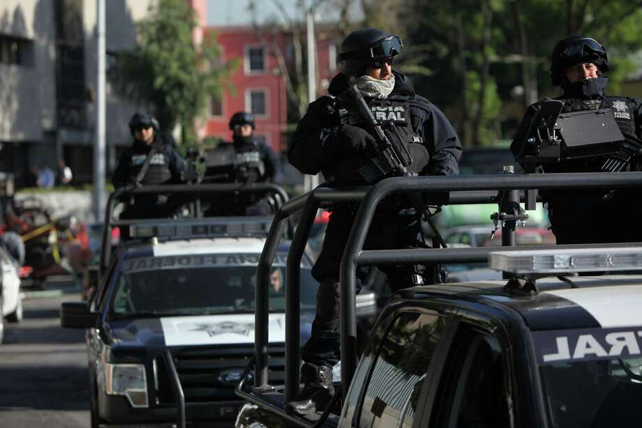 Federal police patrol as part of increased security outside the organized-crime division of Mexico's Attorney General Office where high profile detainees are sometimes shown to the press in Mexico City. Photo: Marco Ugarte / Associated Press / AP