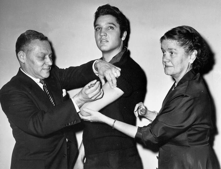 Elvis Presley, the King of Rock 'n' roll, receives a polio vaccine shot in 1956, administered by members of theNew York City Health Department. In recent years, however, opposition to the use of vaccinations has spread among parents who see a link between the shots and disabilities such as autism. A reader urges both parents and politicians to accept the need for vaccinations — and to recognie the harm they can prevent. Photo: /Associated Press / AP